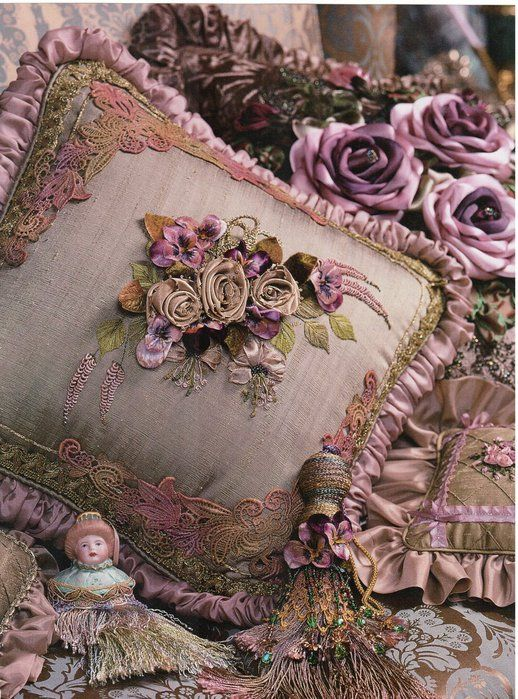 A picture of silk ribbon embroidered pillows
